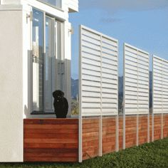 Louvre infill fencing used for Windbreak and privacy screen that matches the modern home