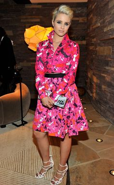 Dianna Agron from DVF's Famous Fans  Dianna Agronstands out from the crowd in a hot pink DVF Spring 2015 cropped jacket and matching skirt.