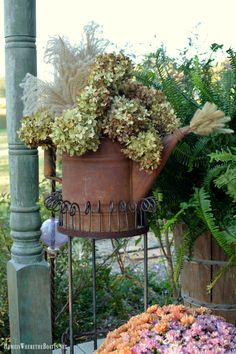 Watering can with hydrangeas and grasses for fall     homeiswheretheboatis.net #pottingshed