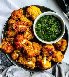 Flavor fanatics look this way! We have a spice filled recipe for you today! Indian-Spiced Cauliflower Wings!!! These yummy, super easy to make cauliflower wings are a healthy alternative to normal chicken wings without losing any of that great taste. Thanks to Anisha for providing this recipe and for using the Zulay Kitchen Stainless Steel Tongs Set to flip over the cauliflower pieces.This delicious recipe is from the blog Upbeet Anisha!KITCHEN PRODUCT USEDStainless Steel Tongs Indian Cauliflower, Cauliflower Buffalo Wings, Spiced Cauliflower, Cauliflower Recipes, Veggie Recipes, Green Chutney Recipe, Chutney Recipes, Finger Food Appetizers, Appetizer Recipes