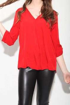 Your eyes aren't playing tricks on you; our Stacy Red Turn Top is chic style perfected, seamlessly blending casual and sexy details into one versatile top! This poly material is airy with a plunging V-neckline. The bottom is as good as the top with a rounded hemline                            In Stock at Online Boutique Shop Ora $27.00 www.shoporas.com