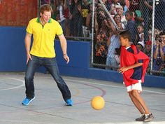 Star Tracks: Thursday, June 26, 2014   PLAY ACTION   He's got World Cup fever, too! Prince Harry goes head-to-head with a young child at the ACER charity for disadvantaged children on Wednesday in São Paulo, Brazil.