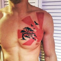 Manly Sun Tattoo Designs For Men On Chest In Red Ink
