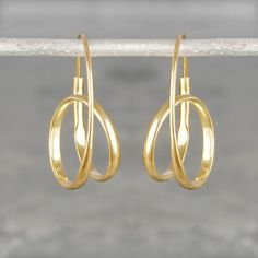 Cool, contemporary and utterly unique, these Double Loop Gold Hoop Earrings feature a looped curl design for maximum impact and minimal fuss. These Double Loop Gold Hoop Earrings are also available in sterling silver and rose gold vermeil. #Otisjaxon #Jewellery
