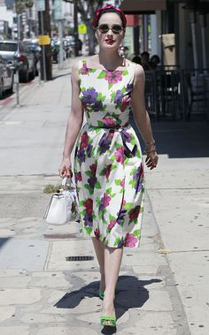 dita von teese in a vintage dress, christian louboutin shoes, and dolce & gabbana handbag.