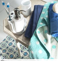 The blue hues of the polker dot and navy hand towels team will with the patterned arabesque floor tile. The vintage style is complete with the simple white ceramic tooth brush holder. Accessories idea by http://capture.setvisions.co.uk/Portfolio
