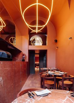 Nómada Chiado, voyage nomade à travers le monde Stone Restaurant, Lisbon Restaurant, Restaurant Owner, Four Rooms, Architecture Magazines, Curved Sofa, Hanging Light Fixtures, Vaulting, Minimalist Design
