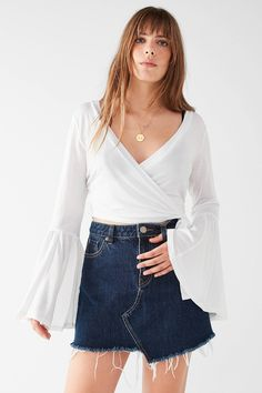 Shop UO Celeste Bell-Sleeve Wrap Top at Urban Outfitters today. We carry all the latest styles, colors and brands for you to choose from right here.