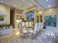 BREAKFAST ROOM-18X12-featuring recessed lighting,ceiling fan, desk with storage hutch, expansive wi ...