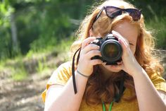 One of our campers taking photos during her Photography Activity at WeHaKee Camp for Girls in Winter, Wisconsin.
