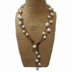 Wendy Mignot Jewelry @ Sarah Carolyn - Music Long White Freshwater Pearl Necklace - Pearls, pearls and more pearls on great leather! #WendyMignot #SarahCarolyn