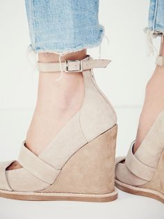 Dakota Wedge | Scrumptious suede make up this open toe wedge sandal featuring cutout detailing. Adjustable ankle strap with elastic. Zipper back makes for an easy on-off. Padded footbed for a comfortable fit.