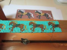 This is a chart to make a beaded loomwork band featuring trotting horses. This pattern also works well for choker necklaces and bracelets and hatbands and