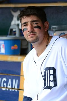 Nick Castellanos of the Detroit Tigers looks on from the dugout during the game against the Houston Astros at Comerica Park on May 2014 in Detroit, Michigan. The Astros defeated the Tigers Get premium, high resolution news photos at Getty Images Detroit Sports, Detroit Tigers Baseball, Sports Teams, Nick Castellanos, Detriot Tigers, Beautiful Men Faces, Mlb Players, Detroit Pistons, Michigan Wolverines