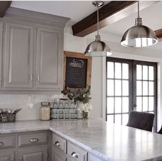 white and grey kitchen + wood beams