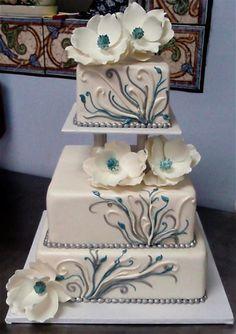 White cake with Tiffany blue n white magnolias