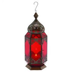 """Moroccan-style hanging candle lantern with an intricate star motif and red glass panels.      Product: Lantern    Construction Material: Metal      Accommodates:  (1) Candle - not included  Dimensions: 17"""" H x 7"""" W   Note: Not recommended for outdoor use   Cleaning and Care: Wipe with dry cloth"""