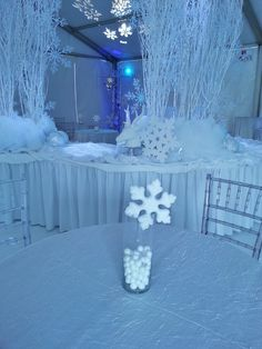 We created a winter white wonderland for a local jewelry store holiday open house.  We went with an all white theme.  There is some...