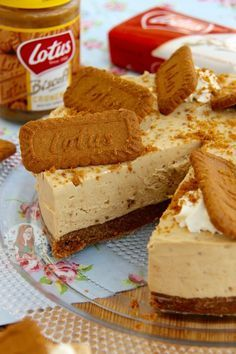 No-Bake Biscoff Cookie Butter Cheesecake!! A delicious No-Bake Biscoff Cookie Butter Cheesecake, sprinkled with more biscuits and whipped cream - Spiced Cookie Heaven.