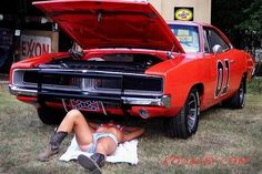 Daisy Duke on her back for The General Lee: