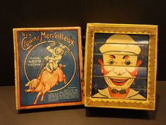 LES JOUETS MAGIC PARIS, FRANCE, 1900. YOU TURN THEM TO DO A DIFFERENT CLOWN FACE. VERY COLORFUL, COMPLETE WITH RARE BOX LID. ALL ORIGINAL, A BEAUTIFUL CARDBOARD BOX WITH 6 SWIVELING ROWS.   eBay!