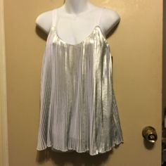 A.n.a silver& white pleated  tank top style Outer shell , 100% polyester, inner body ; 95% viscose, 5% spandex . . This a new top but has  a small flaw as in picture . . Has a white lining underneath .about 26 inch length a.n.a Tops Tank Tops