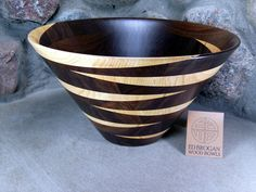 Beautiful ash crescents accent this black walnut bowl.