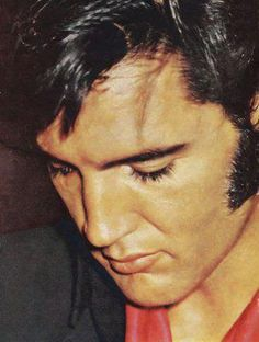 Elvis Presley forever he looks Sad in this photo