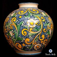 Baroque Vase - Flowers, volutes, leaves. This pattern is the most celebrating design from the Failla Family. This is truly a colorful decore, masterfully hand painted with the traditional colors of Sicily: blue, yellow and green.