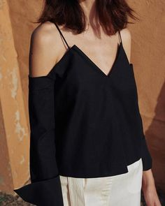 Deconstructed shirt camisole top in crisp cotton. Slips on to be worn, with elastic panel at back and adjustable shoulder straps. Slightly cropped.  2 Lorem ipsum dolor sit amet, consectetur adipiscing elit. Sed ac tellus eleifend, ultricies augue ut, fermentum magna. Nullam suscipit nunc nibh, vitae elementum ante volutpat ut.  3 Lorem ipsum dolor sit amet, consectetur adipiscing elit. Sed ac tellus eleifend, ultricies augue ut, fermentum magna. Nullam suscipit nunc nibh, vitae elementum…