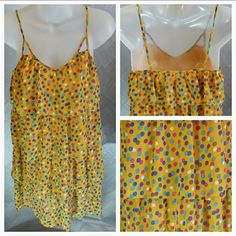 """Playfully flirty Sunshine dress NWOT Add alittle sunshine to your day with this Fun & Playful dress yellow dress!!  4 tiers of playful ruffles layer this fabulously fun dress. Pair with a denim jacket and your favorite booties and you are ready to have an amazing day!!!!  Size Medium. (Size tag not attached) Brand New. V neck Spaghetti straps (adjustable) Yellow with multiple colored polka-dots Length approx:33"""" but will vary depending on where you adjust strapes. Dresses Midi"""