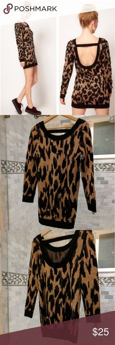 MINKPINK Cheetah Sweater Dress Very chic cheetah sweater dress by Minkpink. It has a deep U back and knit neckline and cuffs. Very warm comfortable and stretchy fit. MINKPINK Sweaters
