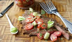 """Seared Seasoned BBQ flank steak garnished with a fresh tomato virgin bloody Mary salsa spiked with a dollop of wasabi, celery salt and a dash of Worcestershire sauce. I know what you are probably wondering what is up with the title of this recipe, """"Wasabi Bloody MARRIED Flank Steak"""". Well this week for sure, it..."""