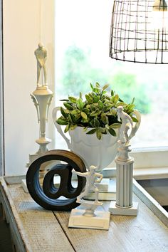 Painting trophies white...brilliant idea! 5 Tips to Make Flea Market Junk Work for You | DIY Your Way