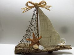 This sailboat is made out of driftwood that I found on the beach. The sails are made out of fishnet and burlap. This sailboat is 12 inches long and 11 inches high. Driftwood Projects, Driftwood Art, Diy Projects, Driftwood Ideas, Sea Crafts, Nature Crafts, Diy And Crafts, Seashell Art, Seashell Crafts