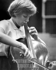 Jacqueline Mary du Pré playing the cello at BBC Maida Vale Studios , playing for a broadcast concert with BBC Symphony Orchestra , 1962 . Ag...