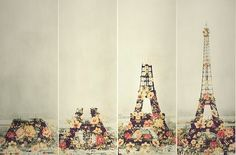 Vintage art of Paris Eiffel Tower being built with many flowers. Would look beautiful framed.