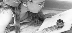 "Tracy Hancock, 11, tries to read while the sparrow she rescued walks on her book. ""Chirpy"" was injured when Tracy found it in her Papillion backyard in July 1973. Tracy nursed the bird back to health with mashed up peas and hot dogs. THE WORLD-HERALD"