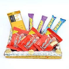 Giftblooms.com presents these mouth-watering chocolates for your loved ones to send on any occasion or festival. Comes with this wonderful rectangular shaped handmade tray decked with silver colored paper and laces. Your loved ones in India will definitely be overwhelmed to receive this trayful of chocolates. Your Gifts to India will bring a million dollar smile on your loved ones faces.