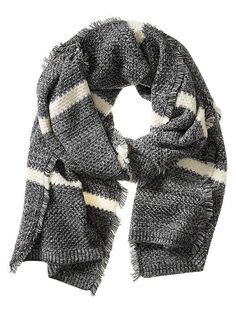 A neutral colored scarf is a necessity during the cold winter months. This gray and cream scarf is sure to keep you warm and stylish | Banana Republic