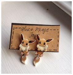 Kawaii Eevee Pokemon Clinging Earrings Fake by AlexsMisfitToys, $7.50 My heart aches for these.