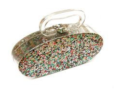 Vintage lucite bag with chunky glitter inclusion.