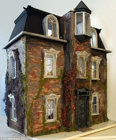 Dollhouses are usually modeled after dream homes but a new design was inspired by the eerie, modern ruins scattered around Detroit (jt-not seen before.This wonderful imaginative house was created by Jen Spectacular. click through for more info and pics)