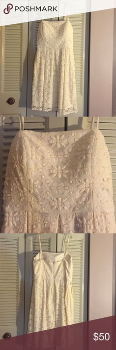 """Dress Beautiful lace dress. Perfect for fancy events or dress down with a denim jacket and cut boots or flats for the fall and winter. Perfect condition. Dry clean only. Missing the size tag, but it is a size 12. It would fit a 10 also. I am 5'3"""" and it hit me right below the knee. Only wore twice. Isaac Mizrahi Dresses Midi"""