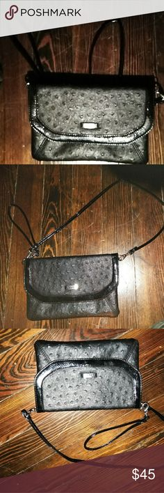 Hand bag Black and is either leather ostrich ?? Bags Totes