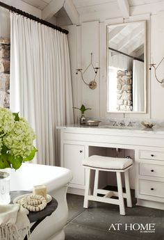 Vanity areas feature Lowcountry Originals sconces and Newport Brass faucets through PC Hardware.    Drapes style