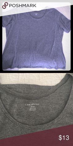 { Lane Bryant} Gray T-Shirt Size 22/24. Cut to flatter your curves, this soft Lane Bryant tee is an essential wardrobe staple. Sleeves hit just above the elbow. Looks great with jeans, skirts and shirts. Like new, worn once, no fading. No stains, no damage. Machine-washable. Smoke-free home. Lane Bryant Tops Tees - Short Sleeve