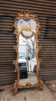 French Rococo style gilt trumeau mirror with painted nude and cherub