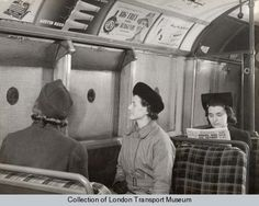 A wartime Tube carriage interior with the anti-splinter window netting as a protection against bomb blast, 1941.