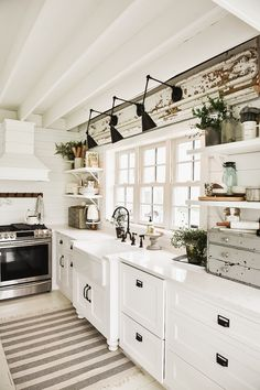 We got new lighting over the sink! Oh we love these arm lights from Wayfair. Check it out. We were going back and fourth between farmhouse and wall sconce... Check out how they turned out.